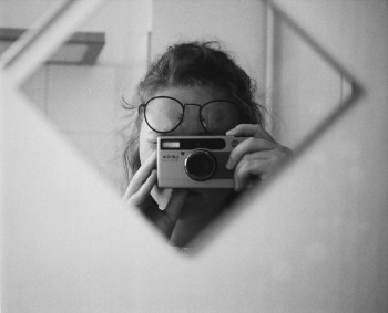 Selfportrait with Minilux and glasses - pm
